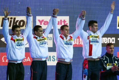Silver medallists Russia's Vladislav Grinev, Russia's Vladimir Morozov, Russia's Kliment Kolesnikov and Russia's Evgeny Rylov celebrate on the podium after the final of the men's 4x100m freestyle relay event during the swimming competition at the 2019 World Championships at Nambu University Municipal Aquatics Center in Gwangju, South Korea, on July 21, 2019. / AFP / Ed JONES
